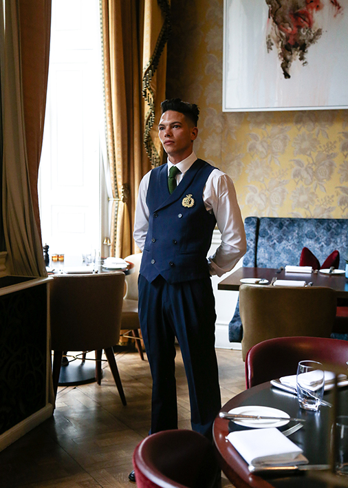 Home House uniforms designed by Field Grey, a bespoke uniform design agency in London, UK.
